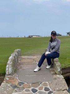 Chelsey pictured after her recent win at the Scottish Junior Open, sitting on the eminent Swilcan Bridge at St Andrews, between the first and eighteenth fairways on the Old Course.
